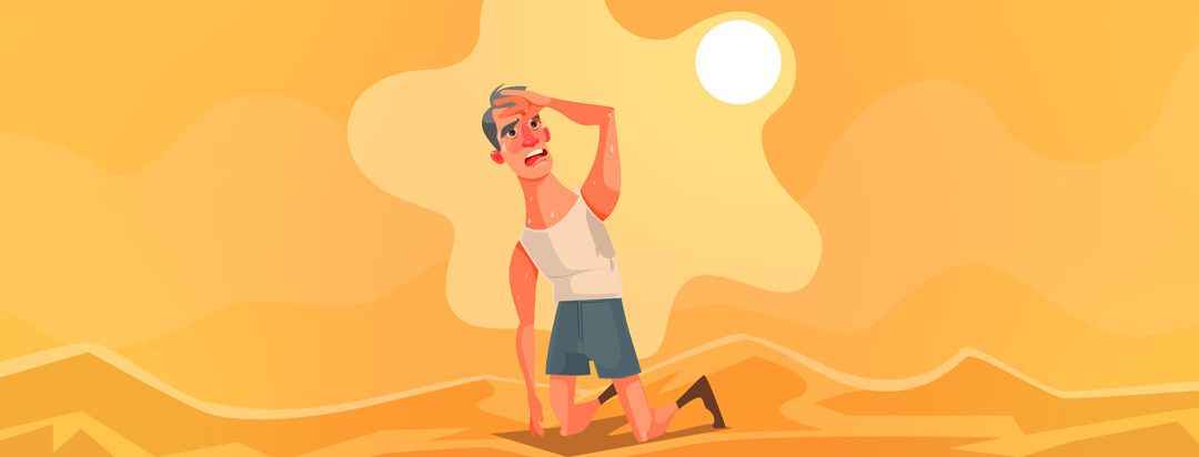 Man in desert looking exhausted and hot