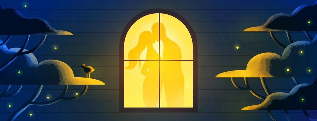 Man & women standing in window embracing