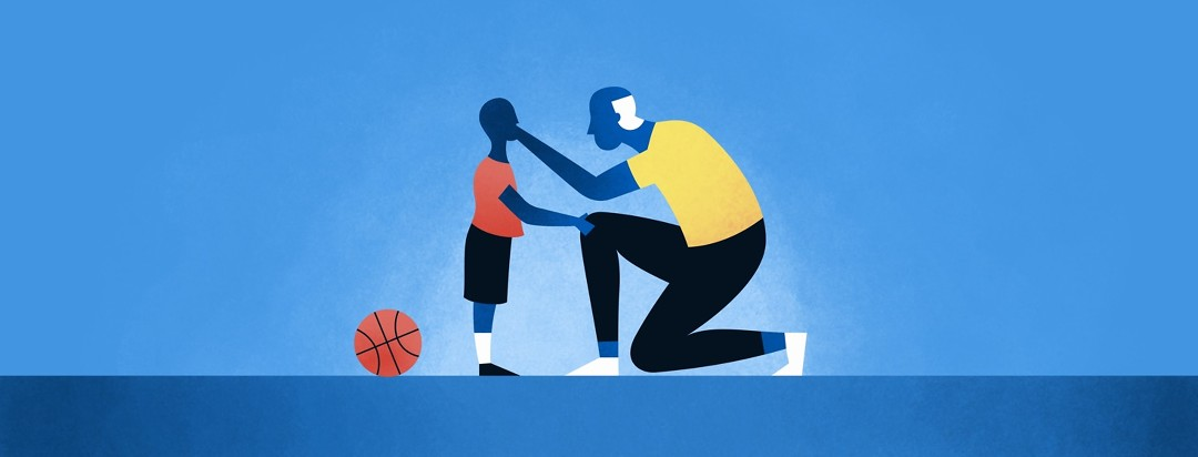 Grandfather kneeling down facing child. The child has a basketball on ground behind him.