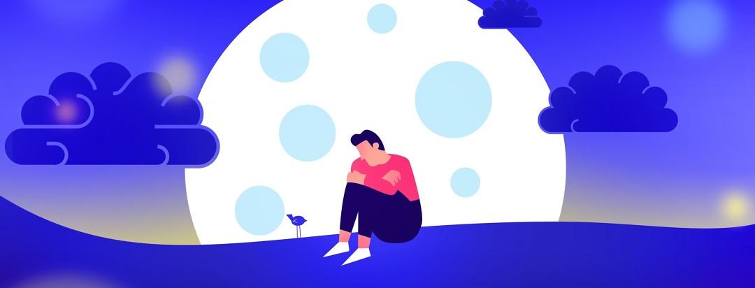 Man sitting alone on a hill