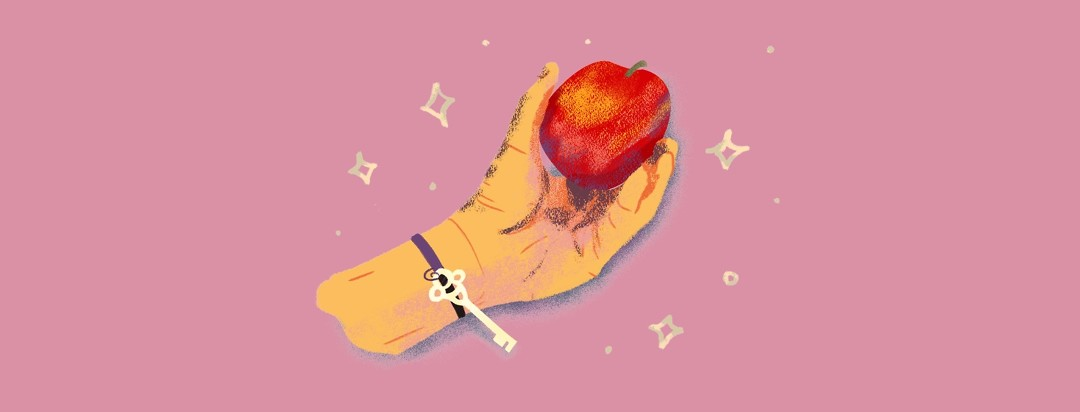 A hand with a key bracelet holds onto an apple, surrounded by sparkles.