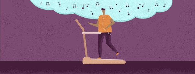 man listening to music while walking on a treadmill
