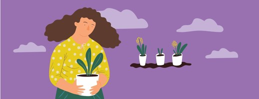 A woman holds a plant in her hand and three plants sit in the background