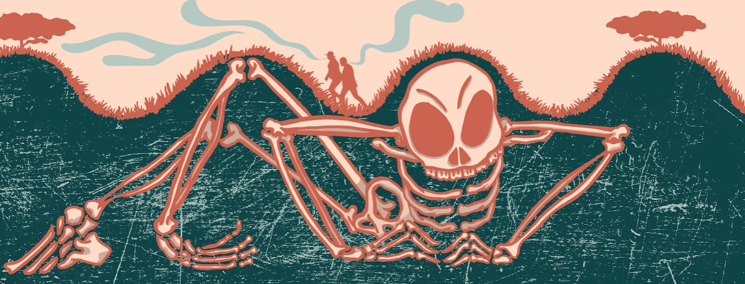 a skeleton lurks under a hill while a couple hikes above and smells it