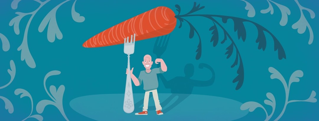 a man holds a giant fork with a giant carrot on it and makes a muscle