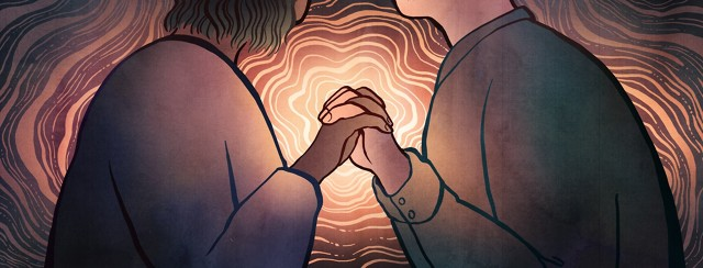 A man and woman link hands, and a soft warm light glows from their point of connection.