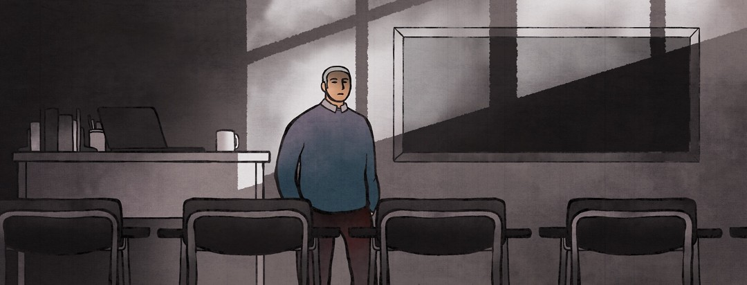 A man stands alone in his former workplace, an empty classroom, as he contemplates going back to work.