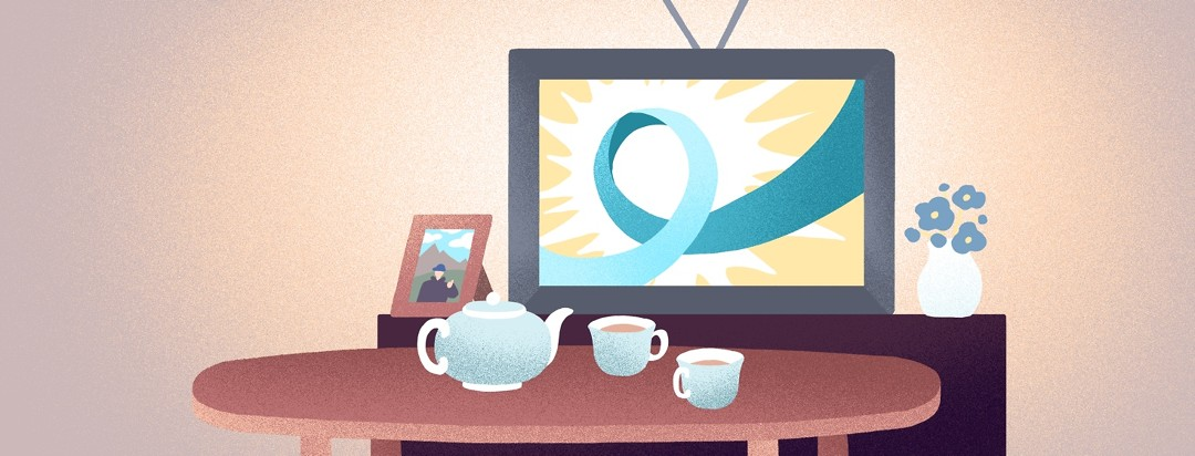 A Prostate Cancer Awareness Month ribbon is displayed on a TV behind a table with a tea set.