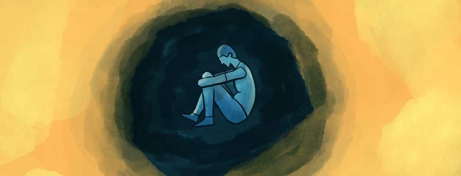 A man sits in a dark cloud.