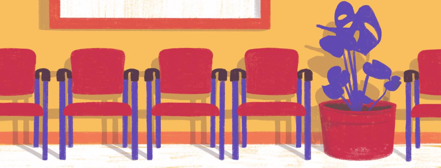 A doctor's waiting room with a row of chairs and a plant.