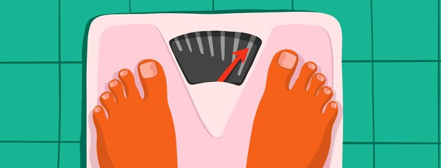 Feet on a scale checking in on weight gain